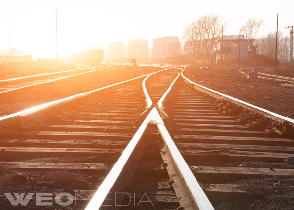 An image of railroad tracks coming to a change